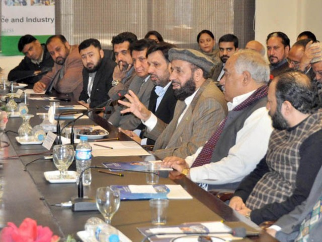 Sardar Mohammad Yousaf chairing a meeting of the Hajj and Umrah Committee at the Rawalpindi Chamber of Commerce and Industry on February 1, 2104. PHOTO: PID