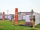 Workers busy in preparations for Sindh Festival at Bagh Ibn-e-Qasim in Karachi on Saturday. PHOTO: ONLINE