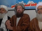 Maulana Samiul Haq with Maulana Abdul Aziz and Ibrahim Khan during the press conference. PHOTO: MUHAMMAD JAVAID/EXPRESS