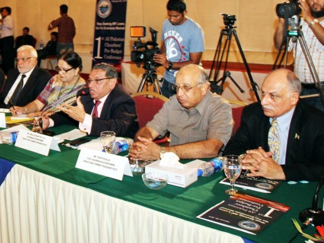 Chairman Business Group Siraj Qasim Teli (3rd L) addressing the All Pakistan Chambers pre-budget conference on Tuesday. PHOTO: ONLINE
