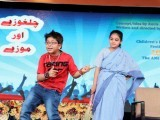 A young boy, acting as Kamil in the play titled Chilghozay aur Mozey, dances while the character of his aunt looks at him. PHOTOS: AYESHA MIR/EXPRESS