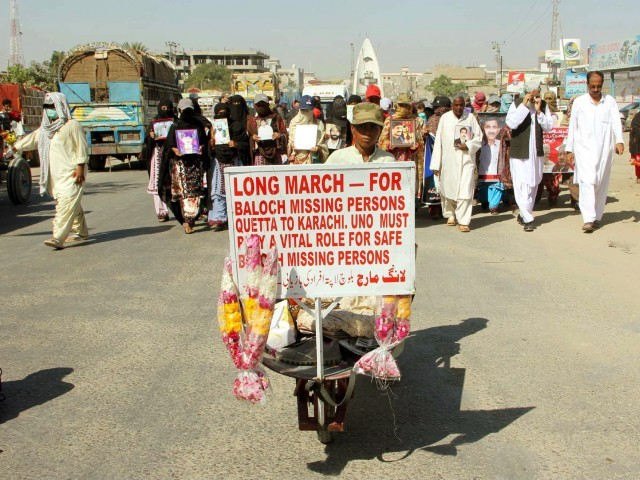 Relatives of missing persons pass through a road during Long March rally. PHOTO:PPI