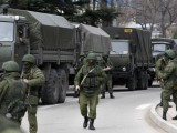 armed-servicemen-wait-near-russian-army-vehicles-outside-a-ukrainian-border-guard-post-in-the-crimean-town-of-balaclava