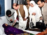 Prime Minister Nawaz Sharif distributing aid among the needy in Mithi on March 10, 2014. PHOTO: PID
