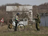 uniformed-man-believed-to-be-a-russian-servicemen-talks-to-a-cyclist-near-a-ukrainian-military-base-in-sevastopol
