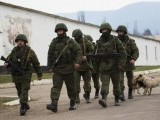 armed-men-believed-to-be-russian-servicemen-march-outside-ukrainian-military-base-in-perevalnoye