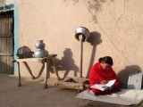 A red jewel: Studying under the sun in Lalian, Chiniot. PHOTO: HAROON ABBAS