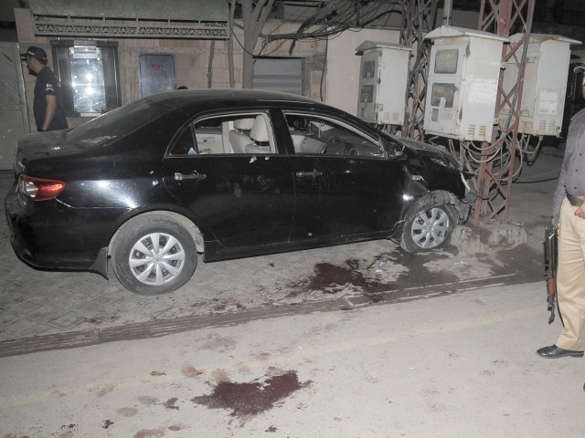 Raza Rumi's car which was attacked in Lahore on Friday evening. PHOTO: TARIQ HASSAN/EXPRESS