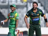 In this file photo, Shahid Afridi (R) reacts following a miss field as Bangladesh batsman Anamul Haque (L) looks on during the eighth match of the Asia Cup one-day cricket tournament between Bangladesh and Pakistan at the Sher-e-Bangla National Cricket Stadium in Dhaka on March 4, 2014. PHOTO: AFP