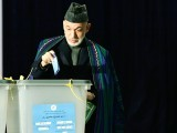 Afghan President Hamid Karzai casta his vote at a local polling station in Kabul. PHOTO: AFP