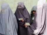 Female Afghan voters line up outside a local polling station to cast their vote in Kandahar. PHOTO: AFP