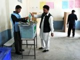 An Afghan voter casts his ballot at a polling station in Jalalabad. PHOTO: AFP