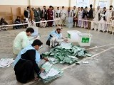 Afghan election officials count ballot papers at the end of polling in Kandahar. PHOTO: AFP