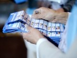 Election workers sort presidential ballots after a polling station was closed for voting in Kabul. PHOTO: AFP