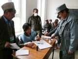 An Afghan policeman votes at a local polling station in Bamiyan. PHOTO: AFP