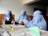 Afghan women cast their ballots at a polling station in the northwestern city of Herat. PHOTO: AFP