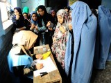 Afghan women register their names to vote at a polling station in the northwestern city of Herat. PHOTO: AFP