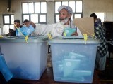 An Afghan voter casts his ballot at a local polling station in Kandahar on April 5, 2014. PHOTO: AFP