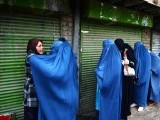 An Afghan official (L) frisks female voters waiting to enter a polling station in Kabul. PHOTO: AFP