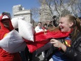 A girl unleashes her super pillow powers at Washington Square Park in New York  PHOTO: REUTERS