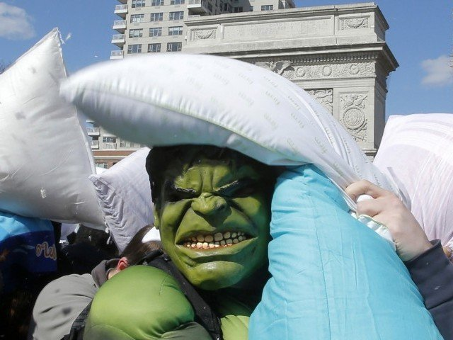 You won't like me when I'm angry: A man wearing a Hulk mask is thrashed by pillows at Washington Square Park in New York. PHOTO: REUTERS