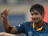 Sri Lanka batsman Kumar Sangakkara gestures towards fans after his team won the ICC World Twenty20 cricket tournament final match against India at The Sher-e-Bangla National Cricket Stadium in Dhaka on April 6, 2014. Sri Lanka won by six wickets. PHOTO: AFP