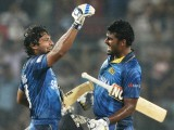 Sri Lankan cricketers Kumar Sangakkara (L) and Thisara Perera (R) celebrate after winning the ICC World Twenty20 cricket tournament final match between India and Sri Lanka in The Sher-e-Bangla National Cricket Stadium in Dhaka on April 6, 2014. Sri Lanka won by six wickets. PHOTO: AFP
