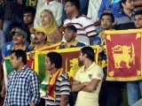 Sri Lankan cricket supporters hold Sri Lankan flags ahead of the ICC World Twenty20 final cricket match between India and Sri Lanka at The Sher-e-Bangla National Cricket Stadium in Dhaka. PHOTO: AFP