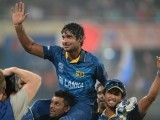 Sri Lanka batsman Kumar Sangakkara (C) gestures towards fans after Sri Lanka won the ICC World Twenty20 cricket tournament final match against India at The Sher-e-Bangla National Cricket Stadium in Dhaka on April 6, 2014. Sri Lanka won by six wickets. PHOTO: AFP