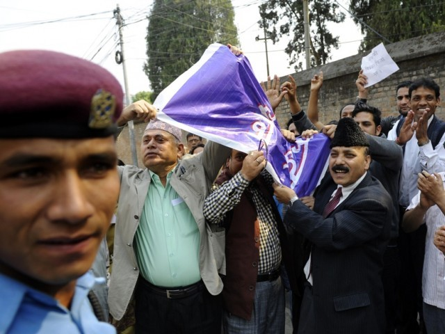 Nepalese victims of war and human rights activists chant anti-goverment slogans during a protest in front of government offices in Kathmandu. PHOTO: AFP