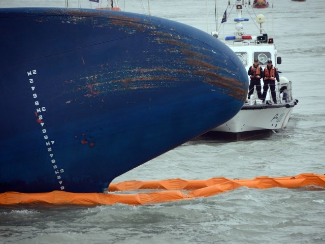 Coast guard members search for passengers near a South Korean ferry that capsized on its way to Jeju island in Jindo on April 17, 2014. PHOTO: AFP/FILE