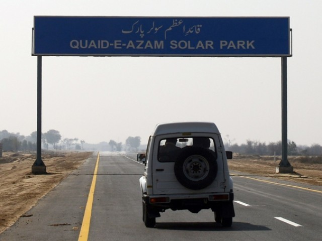 This photograph taken on February 17, 2014 shows a vechile entering the proposed site of the solar energy park at Badaiwani Wala . PHOTO: AFP