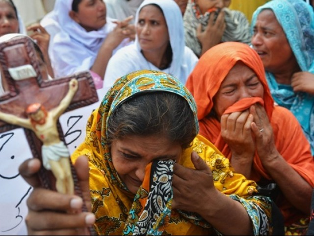 "The report also called 2013 ""one of the darkest years"" for Christians in Pakistan, with the deadliest ever attack on the community mounted in Peshawar in September. PHOTO: AFP/FILE"