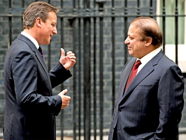British PM David Cameron greets Nawaz Sharif outside 10 Downing Street in central London. PHOTO: AFP