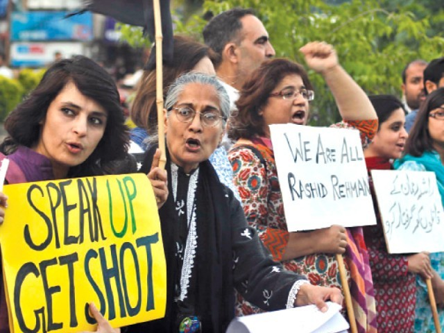 Human rights and civil society activists stage protest in Super Market, Islamabad, against Rashid Rahman's murder. PHOTO: MUHAMMAD JAVAID