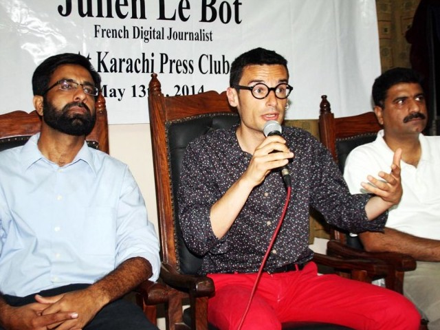 French journalist Julien Le Bot speaks at an event at the Karachi Press Club on Tuesday. PHOTO: ONLINE