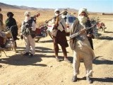 taliban-fighters-pose-with-weapons-while-detaining-two-unseen-men-for-campaigning-for-presidential-candidate-mullah-abdul-salam-rocketi-in-an-undisclosed-location-in-afghanistan-3-2-2-2-2-2-2-2-2-2-3