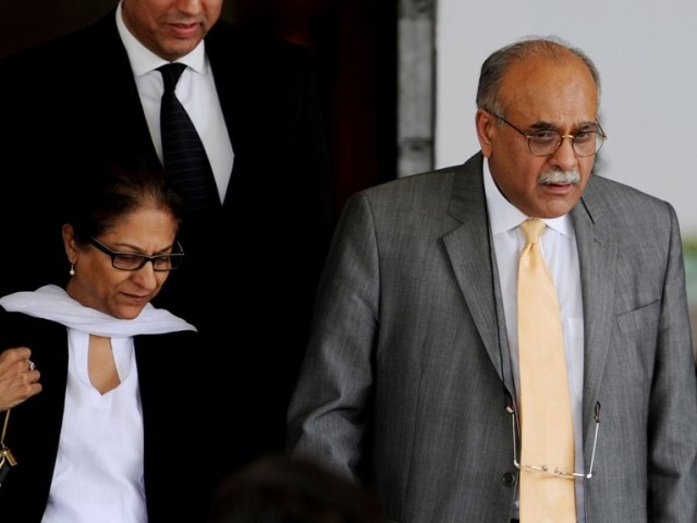 Najam Sethi (R) leaves the Supreme Court with his lawyer Asma Jehangir (L) in Islamabad on May 21, 2014. PHOTO: AFP