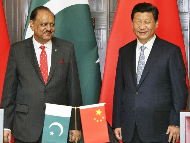 President Mamnoon Hussain (L) and China's President Xi Jinping smile after a signing ceremony at the Xijiao State Guesthouse in Shanghai May 22, 2014. PHOTO: REUTERS