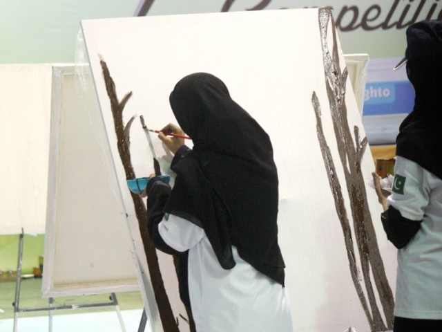 Participants of an art competition paint during the Express Education and Career Expo 2014 in Karachi. PHOTO: ATHAR KHAN/EXPRESS