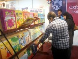 Visitors inspect books put up for display during the Express Education and Career Expo 2014 in Karachi. PHOTO: ATHAR KHAN/EXPRESS