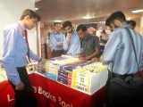 Visitors check out books at a stall during the Express Education and Careers Expo 2014. PHOTO: ATHAR KHAN/EXPRESS