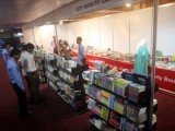 Visitors look at books at a book stall during the Express Education and Career Expo 2014 in Karachi. PHOTO: ATHAR KHAN/EXPRESS