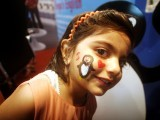 A girl gets her face painted at the Express Education and Career Expo 2014 in Karachi. PHOTO: ATHAR KHAN/EXPRESS