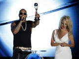Flo Rida gives a speech after receiving an award from Pamela Anderson. PHOTO: REUTERS