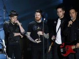 Patrick Stump, Pete Wentz, Joe Trohman and Andy Hurley (L to R) , members of  the US group  Fall out Boy, accept their award. PHOTO: AFP