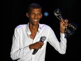Belgian singer-songwriter Paul Van Haver, who goes by the stage name Stromae, is delighted as he holds up two awards. PHOTO: REUTERS