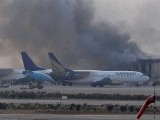Smoke rises after militants launched an early morning assault at Jinnah International Airport in Karachi on June 9, 2014. PHOTO: AFP
