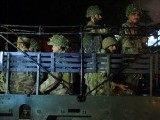 Troops take position at the Karachi airport terminal after the militants' assault late on June 8, 2014. PHOTO: AFP