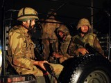 Troops arrive to take position at the Karachi airport terminal after the militants' assault late on June 8, 2014. PHOTO: AFP